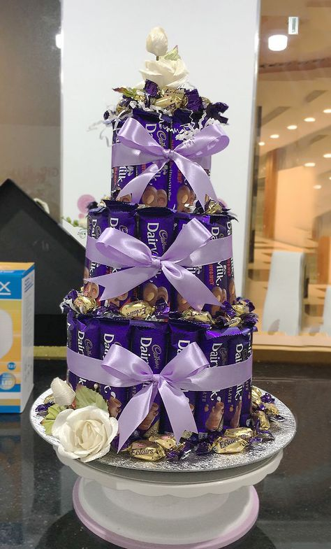 Delectable Cadburys and Eclairs in an enchanting tower, great for birthdays, parties, gatherings