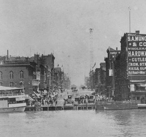 From approximately 1890 showing the base of Woodward Avenue at the Detroit River in Detroit - Michigan. The base of Woodward Avenue is where the ferry landing for Detroit was located, bringing people across the river to Canada and to vacation spots.