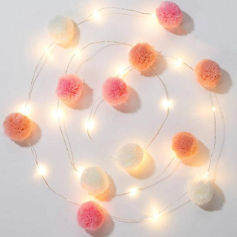 Soften the mood with these fun pom pom lights! Featuring 20 LED lights, these fairy lights are perfect to decorate a bedroom or a party. Light Garland, Pom Pom Garland, Hanging Pom Poms, Star Garland, Pom Pom Decorations, Christmas Decorations, Christmas Ideas, Hipster Bedroom Decor, Bedroom Inspo