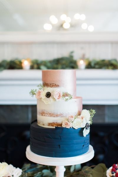 Modern rose gold and navy blue semi naked cake by Frost It Cakery