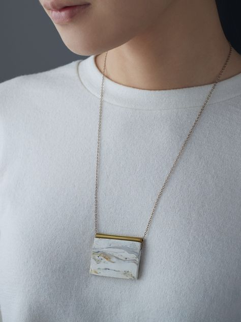 Image of White Slab with Brass Rod