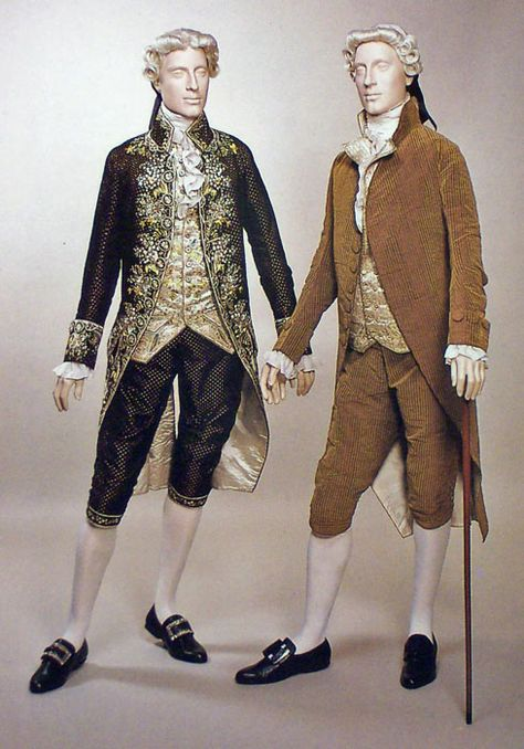 The eighteenth century monied male was often a peacock, eager to display his taste and wealth, and fond of lavishly decorated or patterned fabrics, and bright striking colours. The usual outfit remained the three piece suit of coat, waistcoat and breeches until 1800, when trousers began to replace breeches. Fashionable suits were usually plain woollen facecloth for practical urban or rural wear; woven silks for more formal evening occasions; and highly trimmed and embroidered silk satins and…