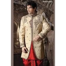 Possess a magnificent ethnic look clad in this cream and red shade dhoti style sherwani. Decorative floral brocade patterns are accentuating the sherwani all over.