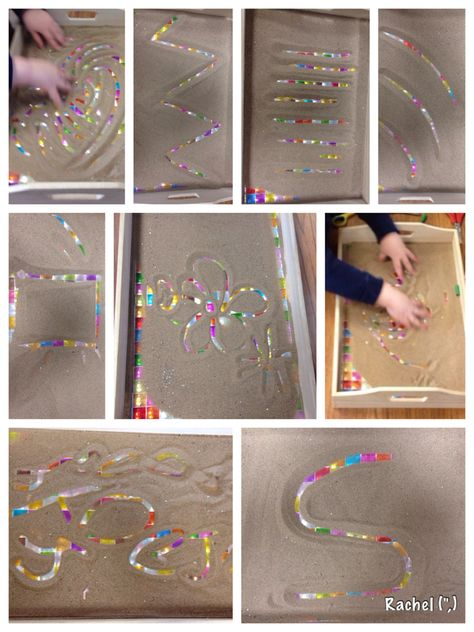 """Mark making in a sand-filled tray - from Rachel ("""",)  Love the idea of putting wrapping paper underneath..."""