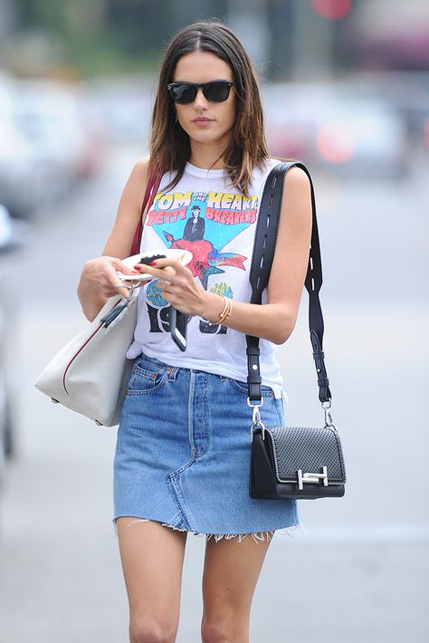 Alessandra Ambrosio is a chic rock chick personified in her band T-shirt and denim skirt.