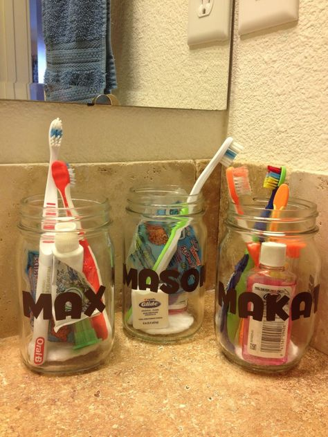 """Tooth Brush Supplies in Mason Jars. Great for kids since some are at different stages and use different types of brushes/toothpaste/floss. Good to keep things organized and also a place to stash those """"baby finger brushes"""" :)"""