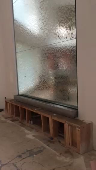 Custom indoor water wall for residence.