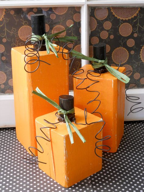 Adorable.. Take a 4x4 and paint them orange, I would add a wine cork to the top for a little extra! :)