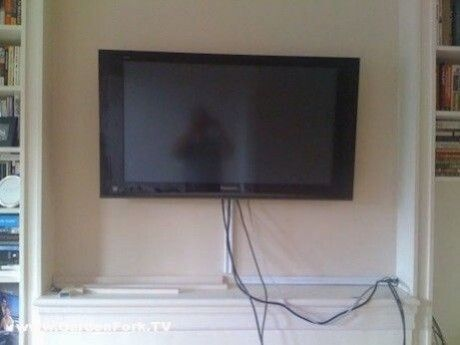 Hang A Tv On A Brick Wall Hang A Tv Above The Fireplace Here S How To Mount An Hdtv On Brick Or Cement Wall In 2020 Wall Mounted Tv Concrete Walls