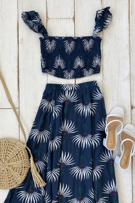 What to pack for vacation? A versatile two-piece set of course! Lulus Trancoso Dusty Blue Floral Print Two-Piece Maxi Dress is the perfect piece to pack for a beach getaway. Mix and match the crop top and maxi skirt for endless outfits. #lovelulus