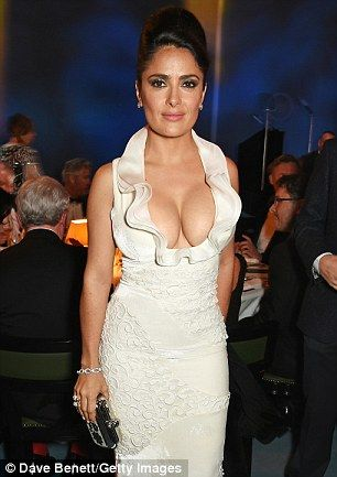 Salma Hayek commands attention in dramatic cleavage-enhancing gown