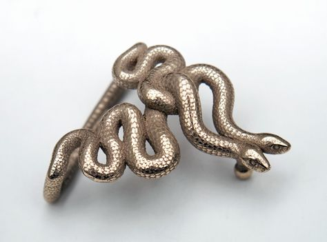 The serpent is one of the oldest and most widespread mythological symbols. It has been associated with good as well as with evil, representing both life and death, creation and destruction. So it's up to you if you see beauty or decay. At least it helps to keep you pants on. This buckle is ready to use. All you need is a snap on leather belt.