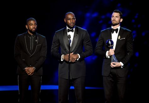 LeBron James Photos - (L-R) NBA players Kyrie Irving, LeBron James