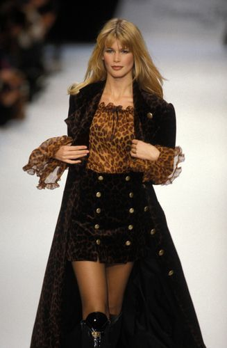 Claudia Schiffer presents a model by Chantal Thomass at Ready To Wear Fall Winter show on March 1994 in Paris, France.
