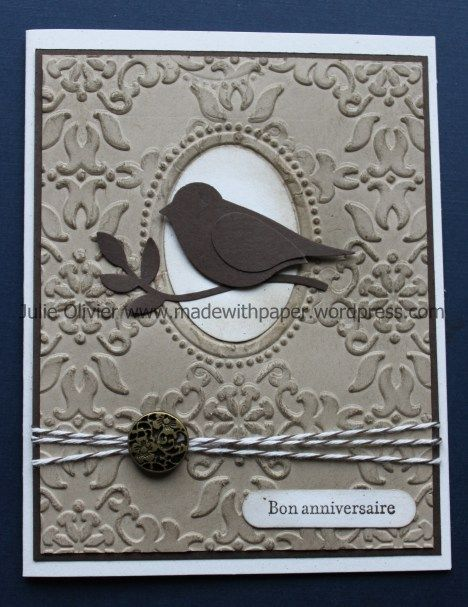"""By Julie Olivier. Dry emboss Crumb Cake cardstock using """"Vintage Wallpaper"""" folder. Die cut oval & emboss using oval designer frame folder & an oval shim (2-3 thicknesses of cardstock) on top of folder over oval design. Sponge design with Early Espresso ink. Punch bird & leaf using SU Two-Step Bird Punch. Attach Crumb Cake piece to Early Espresso mat. Add twine & brad. Attach to white card base. Add bird & sentiment."""