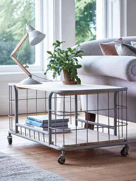 Make an industrial statement with our versatile cage trolley table.  With a caged middle and rustic oak wood top, this strong metal table is ideal for tidying away and holding your coffee and cake. Each table includes four castor wheels, a oak wood top and shelf and whitewash metal frame that exudes industrial style.