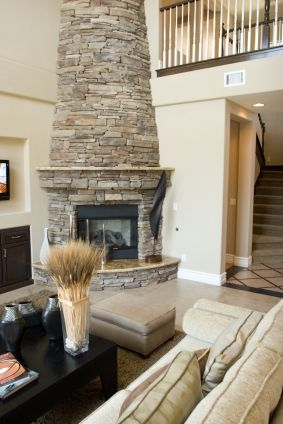 Oooo..rounded and tapered stone corner fireplace. | Great Room ...