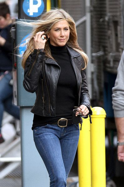 jennifer aniston: black leather jacket, black polo neck top and jeans with a big buckle belt.