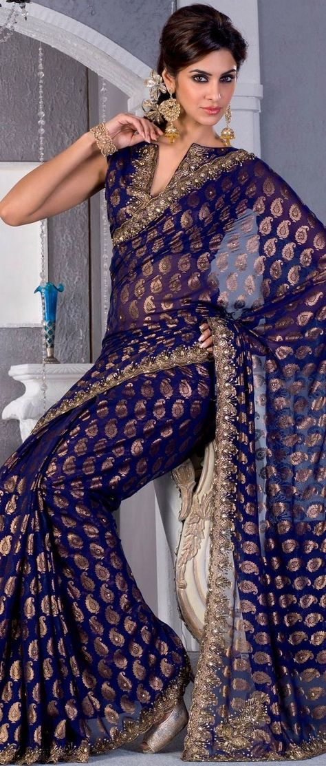 Deep blue georgette saree fabulously designed with Sea Border, golden print, zari and cutdana work.