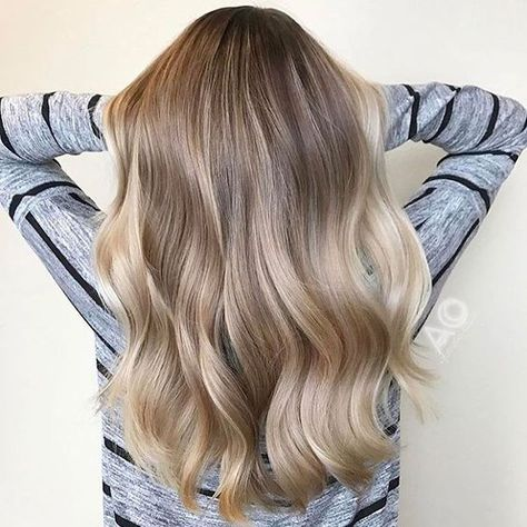 Soft Champagne | We love a glass of champagne to celebrate a special occasion (or just weekend brunch), but the bubbly drink is now making its way into salons—in the form of a gorgeous new hair color. Apparently, hair colors inspired by drinks are already a thing, and champagne hair is just the latest pin to tack on to 2018's hair color trends. You might picture champagne hair as simply another blonde but it's much more versatile. It does have a blonde slant, but it can work on light brunettes
