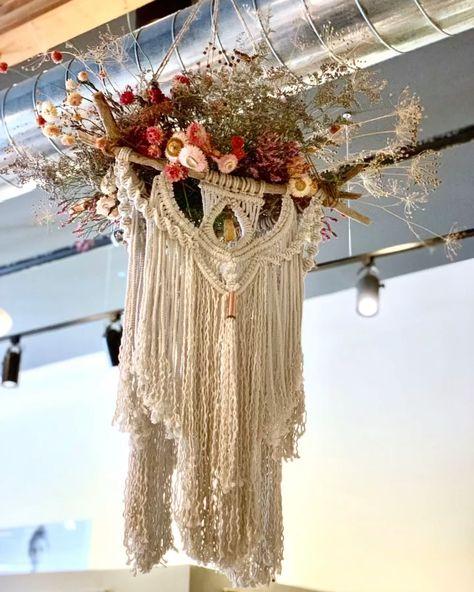 Fiber artist Lucy Lanuza teams up with Hana Floral Studio to create art for Boho Lifestyle shop in Napa. Come and see! #art #artinstallation #windowdisplay #visualmerchandising #macramewallhanging #fiberart #bohemiandecor #bohodecor