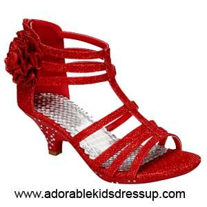 Kids high heels in red.  Shimmering flower on the side, zipper back, sparking glitter infused fabric. Little girls high heels in sizes 8-4.