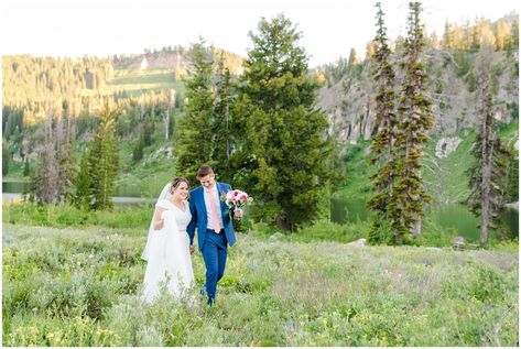 Bride and groom portraits in the Utah mountains wearing flowy wedding dress and cornish blue suit with pink and white florals   Summer Mountain wildflowers   Tony Grove Summer Formal Session   Jessie and Dallin Photography #mountainwedding #utahmountains #firstlook #tonygrove #tonygrovewedding #wildflowerwedding #rockymountainwedding #rockymountainbride #utahwedding #utahweddings #utahbride #utahbrideandgroom #sunsetwedding #formalsession #utahelopement