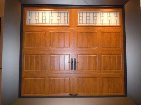 Clopay Gallery Collection grooved panel steel garage door. Medium Oak Ultra-Grain finish. Trenton windows.