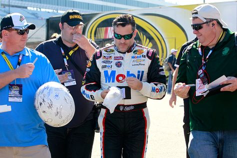 PHOTOS: Tony Stewart signs autographs for fans before the start of the AAA 400 at Dover International Speedway. View more photos from Dover here: http://www.stewarthaasracing.com/media/gallery/index.php