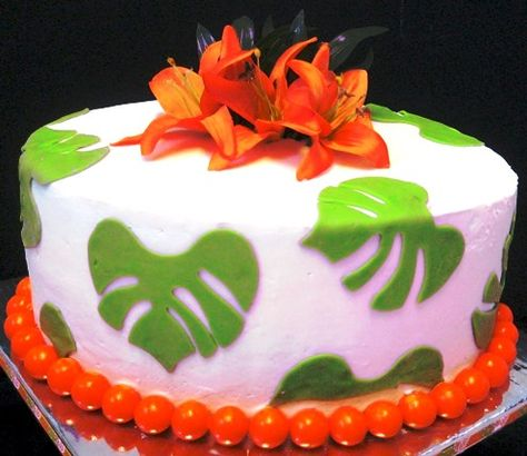 Oval one tier tropical wedding cake in lime green and orange.