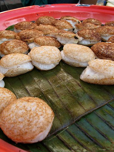 kha nom khok - balls made of glutinous rice powder flavored with coconut milk.