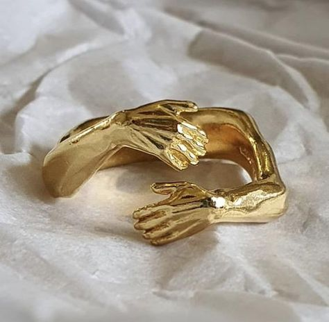 'Hug ring', designed to look like arms wrapping around your finger. Original design carved in wax then lost wax cast into sterling silver and gold or rose gold plated.Piece weighs approximately 14g.Shown in a size P, and available in ring sizes J-V.