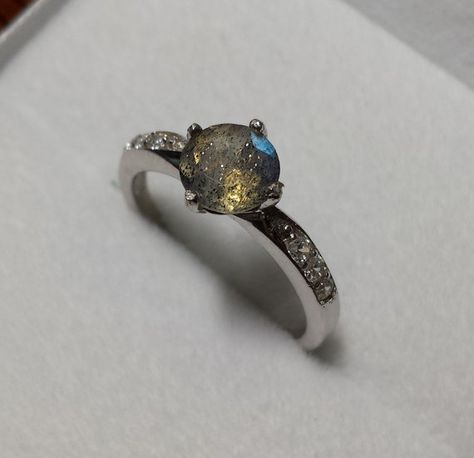 Hello, for sale is a beautiful solitaire ring made from solid sterling silver. The larger stone measuring wide is a natural Labradorite