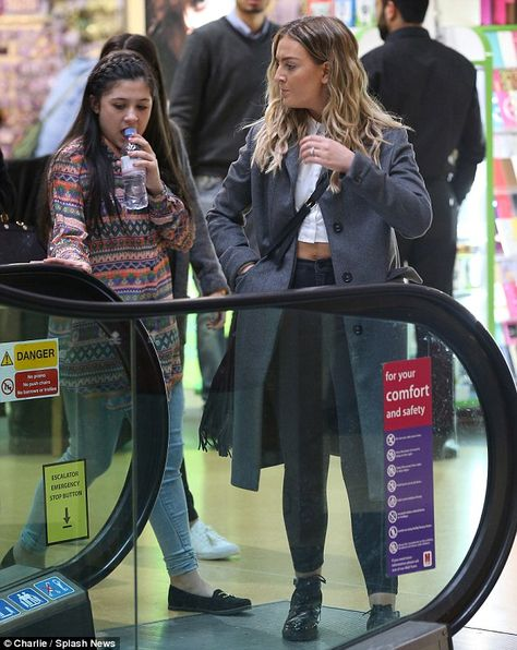 Perrie Edwards shops with fiancé Zayn Malik's mother and sisters