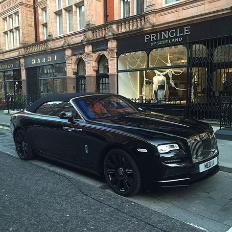 2016 Rolls-Royce Dawn, as seen in Mount Street, Mayfair W1: Twin-turbo 6.6-litre V12;  produces 563bhp at 5250rpm, 575lb at 1500rpm, driving the rear wheels through an 8-speed ZF automatic gearbox, which links with the sat-nav to automatically pre-select the next appropriate gear. It can get from 0-62mph in 4.9sec, and reach a limited 155mph. Combined fuel economy: 19.9mpg; CO2 emissions: 330g/km. It is 5285mm long, 1947mm wide, 1502mm high, wheelbase:  3112mm; weight: 2560kg. Price…