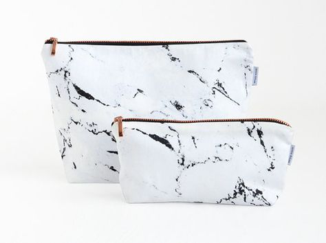 marble and copper pouch  A bag in marble look with a zipper made of copper. A simple, factual case for the little things that you like to take along.