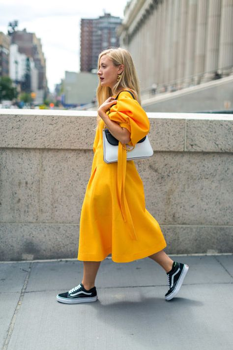 NYFW | Street Style Trend Alert: Skirts and Sneakers  Feminine frocks and sporty sneakers are a thing at this year's coveted New York Fashion Week. Check out some of our favorite looks from the week and get inspired to take this playful trend from the jungle gym to the urban jungle.  Kate Foley - Photographed by Diego Zuko for Harper's Bazaar