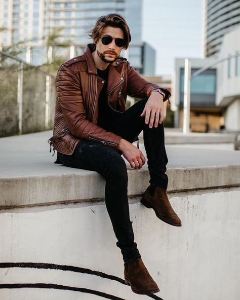 street style combo with a brown leather jacket black skinny denim dark brown suede boots sunglasses black t shirt and watch