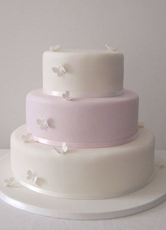 'Candy Butterfly' wedding cake    : Simple clean lines on this beautiful  wedding cake, create a minimal look, that is enhanced  with delicate handmade sugar butterflies.    (for flavours please see 'Fillings & flavours') - maisiefantaisie.co.uk