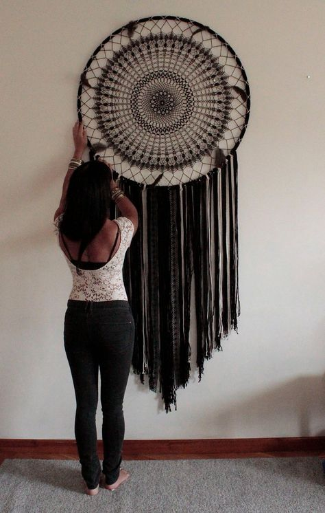 This beautiful giant black dream catcher wall hanging is a beautiful statement of the bohemian style. The crochet part of the dream catcher took about a week to make!  This black bohemian wall decor has a magnetic energy of a handmade item. It is made of crochet doily, lace, ribbons, macrame ropes and feathers.  I imagine this black giant dream catcher on the top of your bed to make a wonderful boho bedroom decor or in your living room to make your bohemian home feel even more mystical. This ...