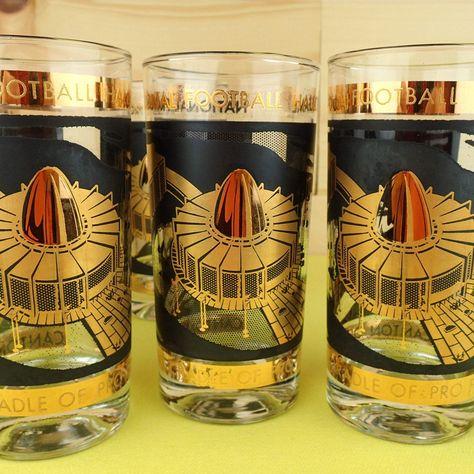 """Set of 6 vintage Football Hall of Fame glasses. They are 5-1/2"""" high with a 2-3/4"""" mouth and have thick heavy bases. These are in varying conditions. Three have most of the gold intact while the other three have experienced too much time in the dreaded dishwasher and have lost some of the gold. This would be a great set to have so that you can display some and actually use the others without worrying about marring the design. Everybody wins!!!"""