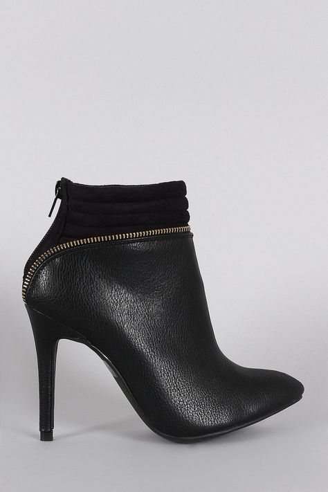These classic pointy toe silhouette, quilted vegan suede cuff with zipper detailing, and wrapped stiletto heel. Finished with cushioned insole and rear zipper c