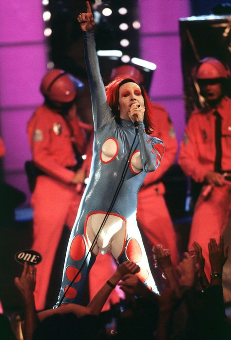 Los Angeles, CA: Shock rocker Marilyn Manson maintained his reputation when he performed at the 1998 VMAs in this sexually androgynous ensemble.