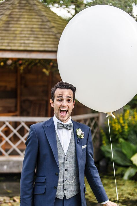 Herringbone waistcoat & bow tie with blue suit - Image by Lina and Tom Photography - An outdoor DIY wedding ceremony in Cambridgeshire England with bright blue colour scheme, huge balloons, many rustic home made touches, dress by Allure Bridals