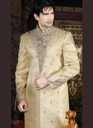 Be a head turner dressed in this gorgeous cream shade sherwani. Decorative jacquard patterns are accentuating the sherwani all over. Beautiful paisley buttas embellished with zardosi and beads adds further charm to it.