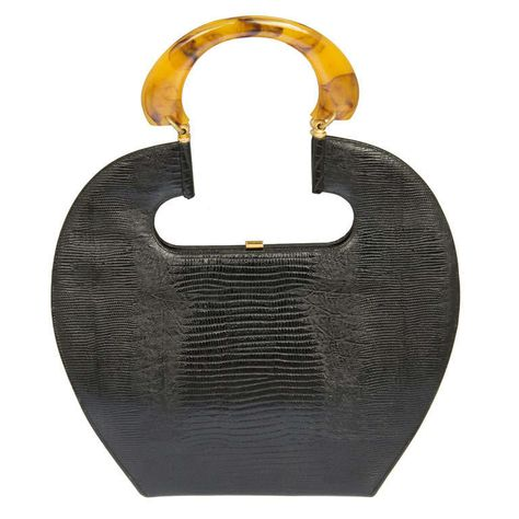 Large and Sculptural Handbag with Bakelite Handle | From a collection of rare vintage handbags and purses at http://www.1stdibs.com/fashion/accessories/handbags-purses/