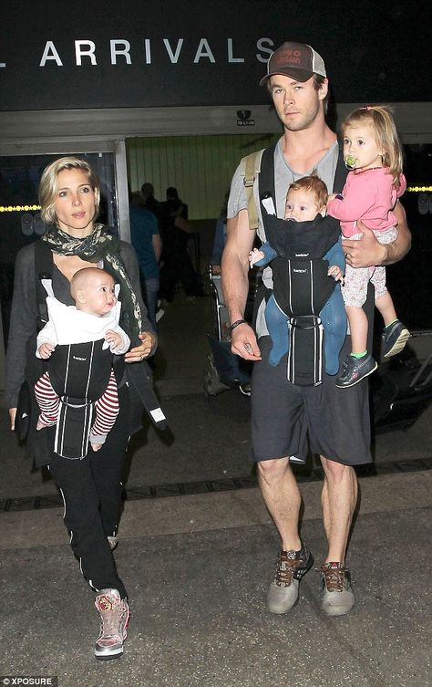 Baby love! The actor and his model partner seemed relaxed with their brood of kids and they know they will find HUMPhooks permanent swivel purse hooks at any aiport - provided for convenience of bags - www.humphooks.com