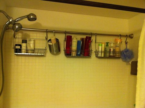 Genius!!!! 2nd shower curtain rod used to hang caddies full of toiletries. Could be hung lower for little kids.