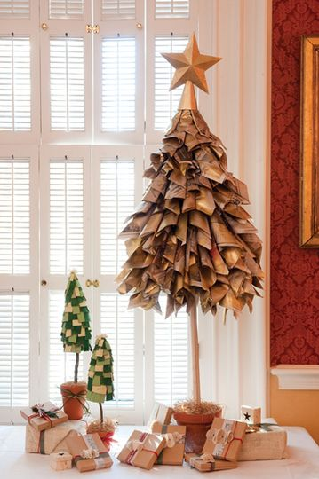 Newspaper Christmas craft> Spray paint with gold, texturize, then roll into a loose cones and glue over a styrofoam cone in layers. Top with an ornament.