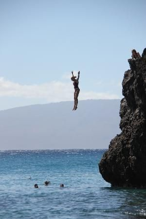 Ka'anapali Beach: Jumping off Black Rock. Visit the beach on Day 7 of the Rose and Gully Maui itinerary.